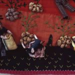 "This detail of an ""arpillera"" reveals the craftsmanship of Helda Morales, who hand-stitched the potatoes and the outfits adorning the figures. Courtesy of Georgia Council for the Arts"