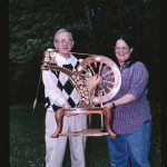 Master and Apprentice, spinning wheel carving