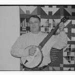 Bob Flesher with handmade banjo