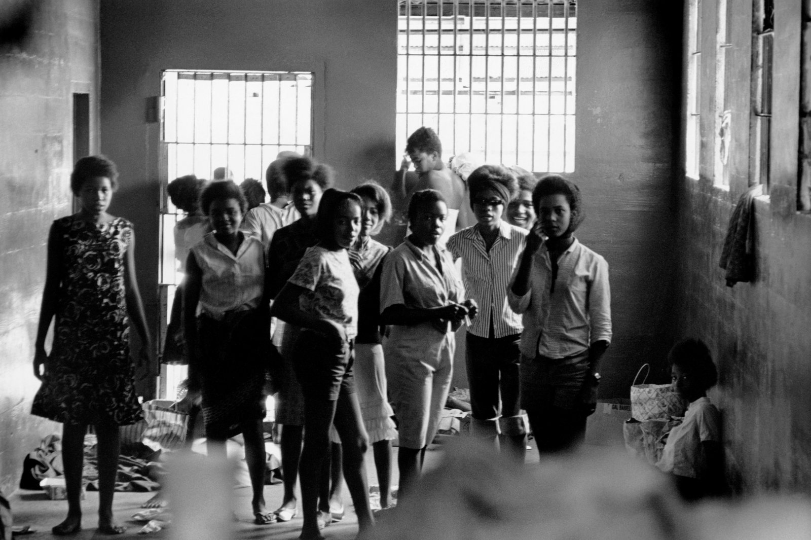 African American girls being held in a Georgia stockade after being arrested for demonstrating segregation in August 1963.