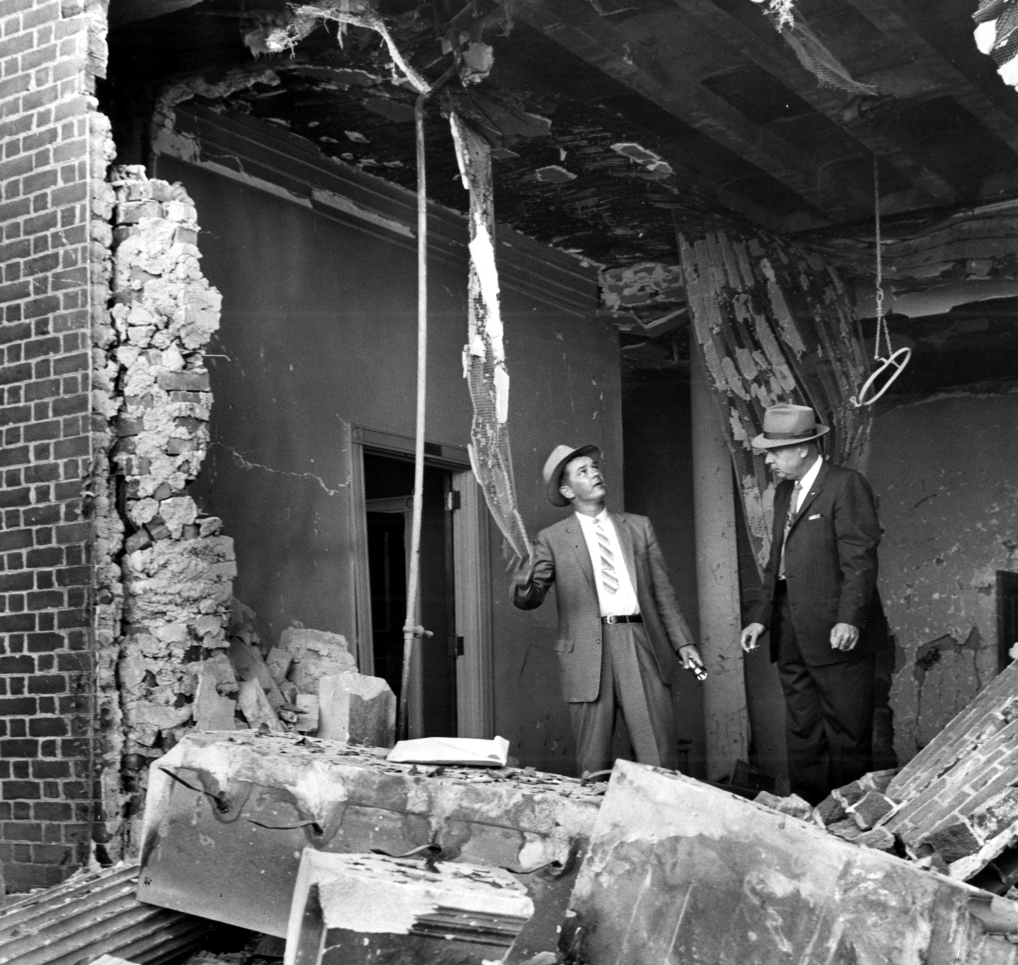 Atlanta Police examine the destruction of the Temple bombing in Atlanta in October 1958.
